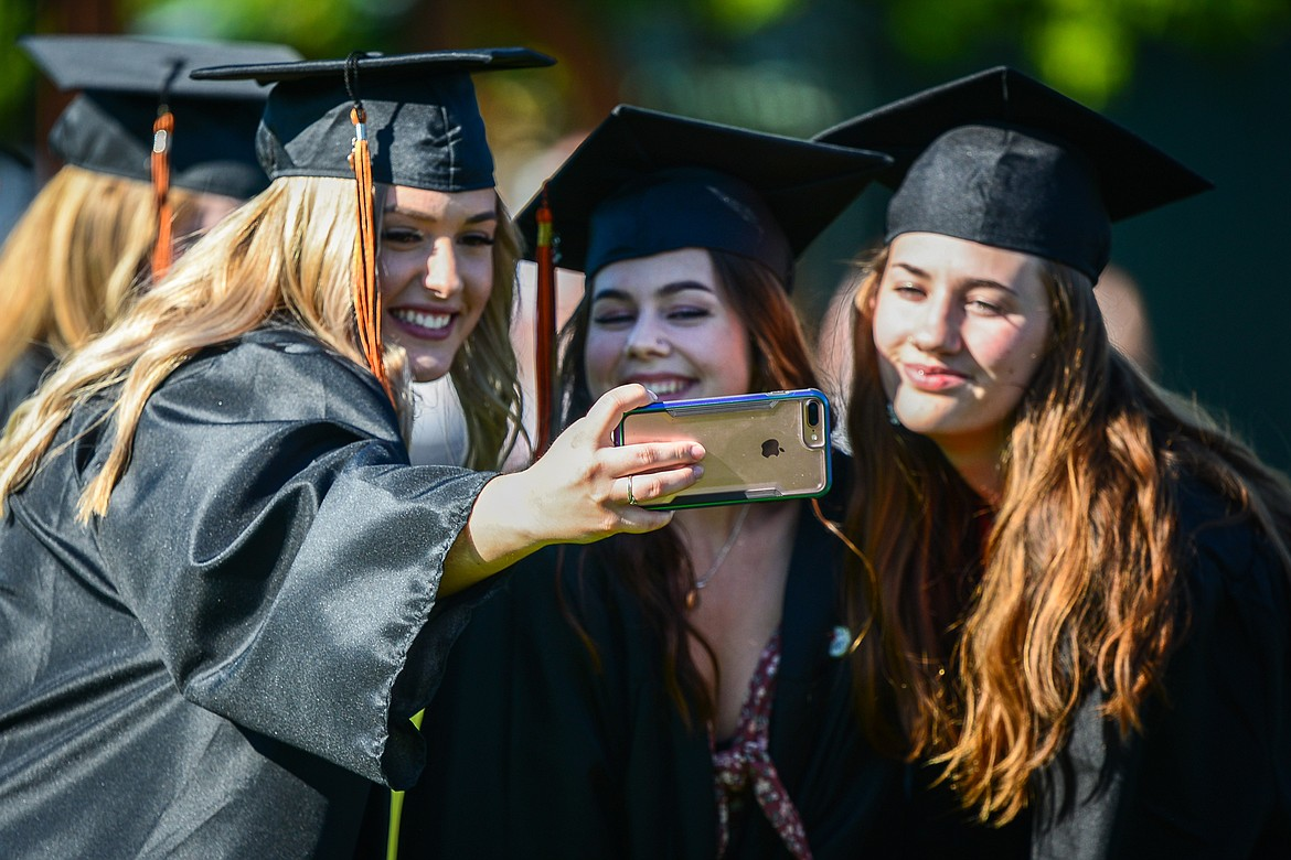 Graduates take photos before the Flathead High School Class of 2020 commencement ceremony at Legends Stadium on Friday, May 29. (Casey Kreider/Daily Inter Lake)