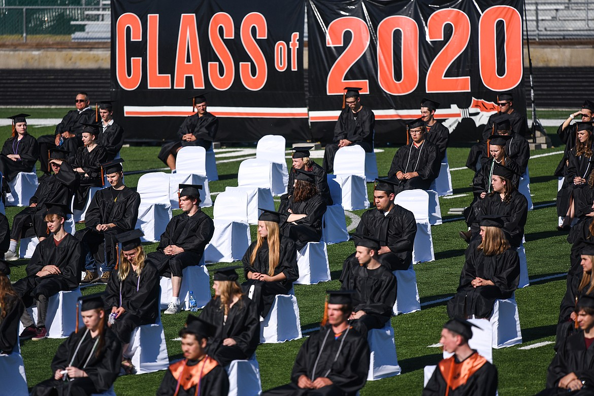 Graduates take their seats at Legends Stadium during the Flathead High School Class of 2020 commencement ceremony on Friday, May 29. (Casey Kreider/Daily Inter Lake)