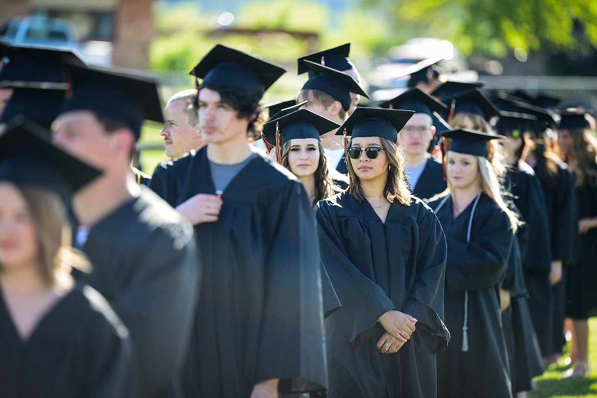 Graduates line up to take their seats at the start of the Flathead High School Class of 2020 commencement ceremony at Legends Stadium on Friday, May 29. (Casey Kreider/Daily Inter Lake)