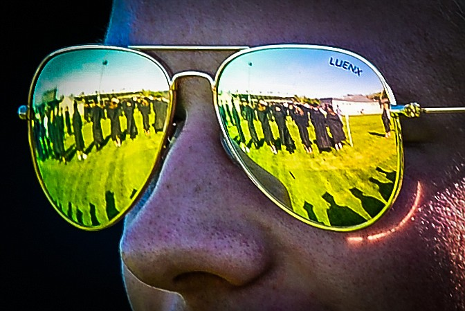 Fellow classmates are reflected in the sunglasses of a graduate before the Flathead High School Class of 2020 commencement ceremony at Legends Stadium on Friday, May 29. (Casey Kreider/Daily Inter Lake)