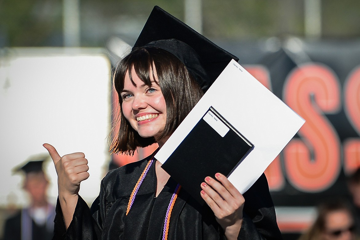 Graduate Neila Danley smiles and gives a thumbs-up after receiving her diploma at the Flathead High School Class of 2020 commencement ceremony at Legends Stadium on Friday, May 29. (Casey Kreider/Daily Inter Lake)