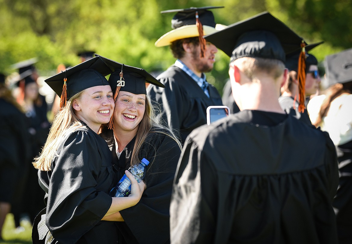 Graduates Eislin Muonio, left, and Kailey Milbrandt have their photo taken by Job Johnston before the Flathead High School Class of 2020 commencement ceremony at Legends Stadium on Friday, May 29. (Casey Kreider/Daily Inter Lake)