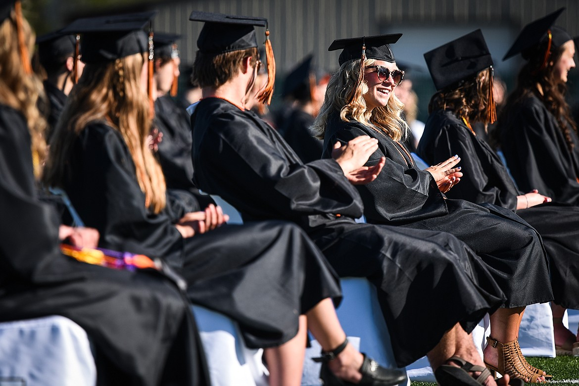 Graduates smile and clap during the Flathead High School Class of 2020 commencement ceremony at Legends Stadium on Friday, May 29. (Casey Kreider/Daily Inter Lake)