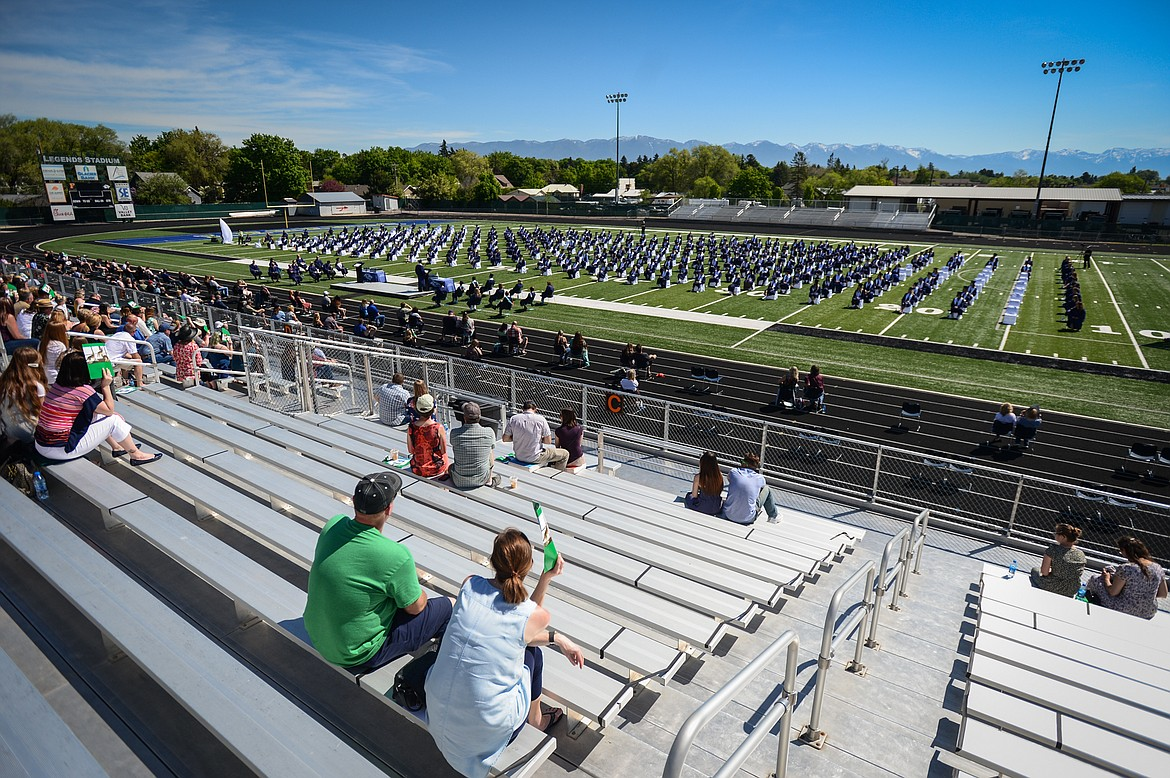 Graduates take their seats spread out across the field at Legends Stadium during the Glacier High School Class of 2020 commencement ceremony on Saturday, May 30. (Casey Kreider/Daily Inter Lake)