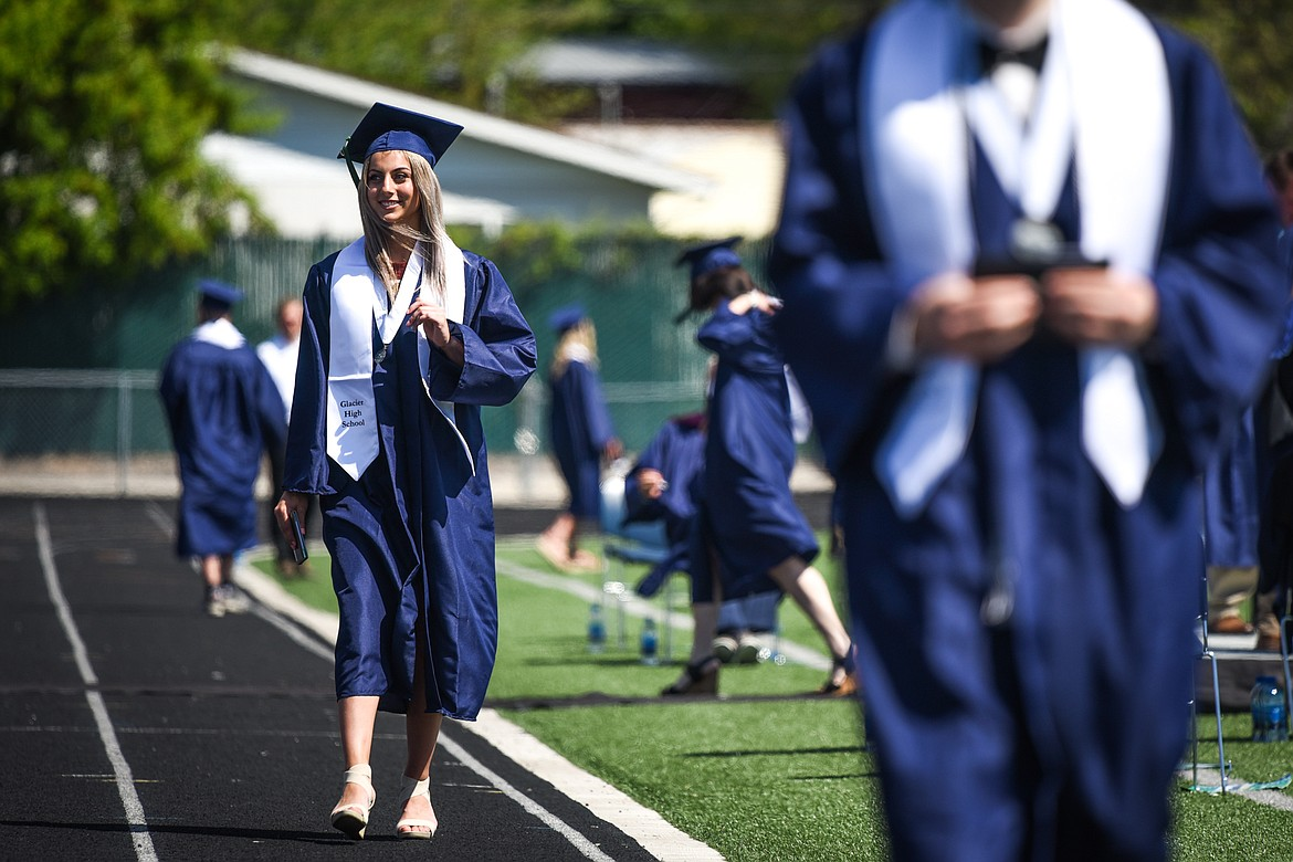 Graduate Faith Brennan waves to the crowd after receiving her diploma at the Glacier High School Class of 2020 commencement ceremony at Legends Stadium on Saturday, May 30. (Casey Kreider/Daily Inter Lake)