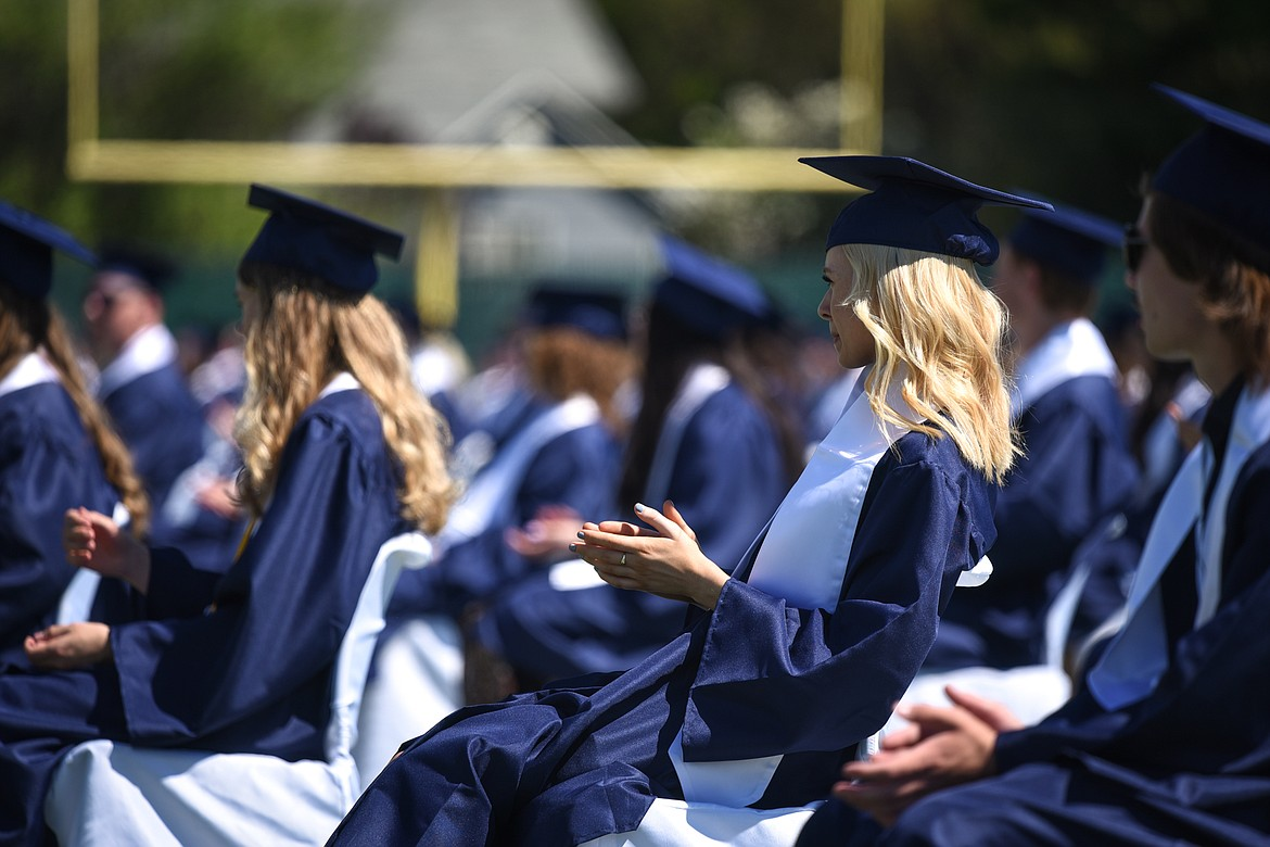 Graduates clap as they sit spread out across the field at Legends Stadium during the  Glacier High School Class of 2020 commencement ceremony on Saturday, May 30. (Casey Kreider/Daily Inter Lake)