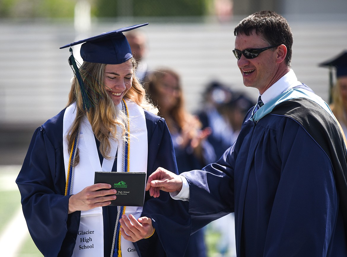 Graduate Kira Barney receives her diploma from principal Micah Hill at the Glacier High School Class of 2020 commencement ceremony at Legends Stadium on Saturday, May 30. (Casey Kreider/Daily Inter Lake)