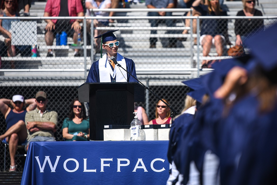 Graduate Simon Hill, who shared Masters of Ceremony duty with classmate Sophia Smith, speaks to the class of 2020 during the Glacier High School commencement ceremony at Legends Stadium on Saturday, May 30. (Casey Kreider/Daily Inter Lake)