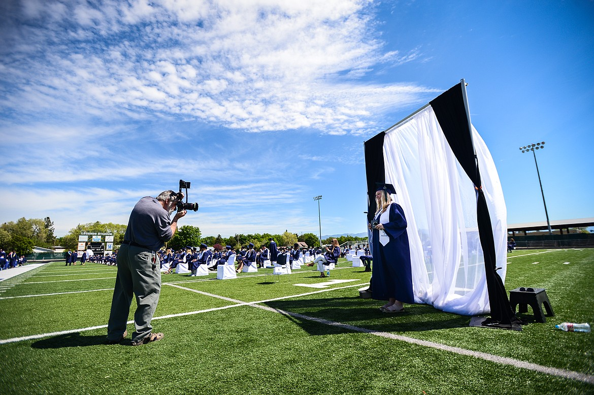 Graduates have their photo taken by photographer Mike Layne after receiving their diplomas at the Glacier High School Class of 2020 commencement ceremony at Legends Stadium on Saturday, May 30. (Casey Kreider/Daily Inter Lake)