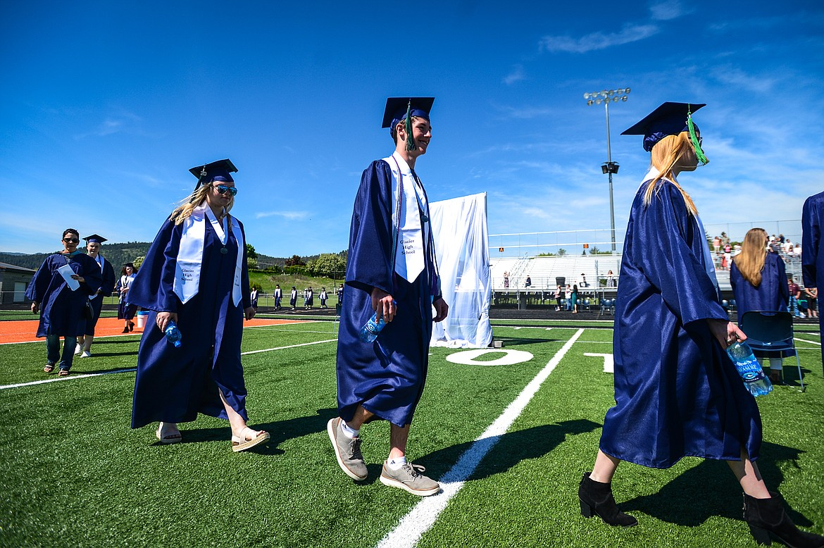 Graduates make their way to their seats during the Glacier High School Class of 2020 commencement ceremony at Legends Stadium on Saturday, May 30. (Casey Kreider/Daily Inter Lake)