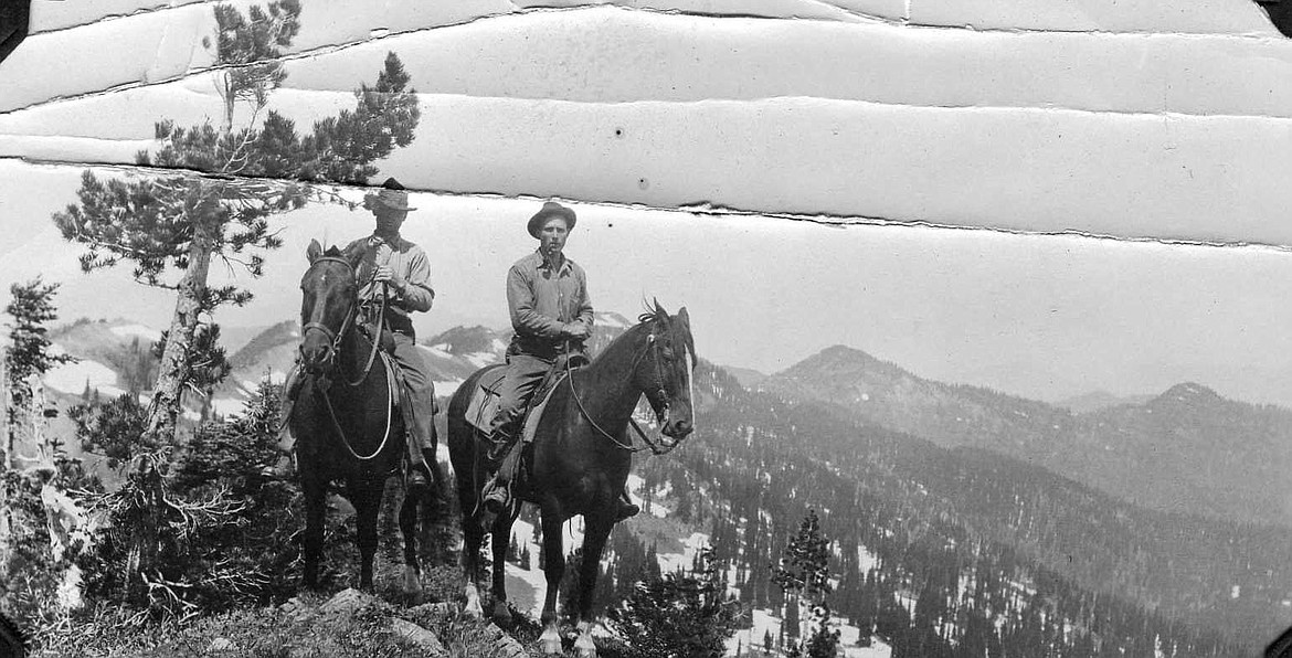 Ranger Thompson & L.G. Hornby on L.O. inspection, On ridge near top of Mtn Aeneas.   Courtesy of the U.S. Forest Service