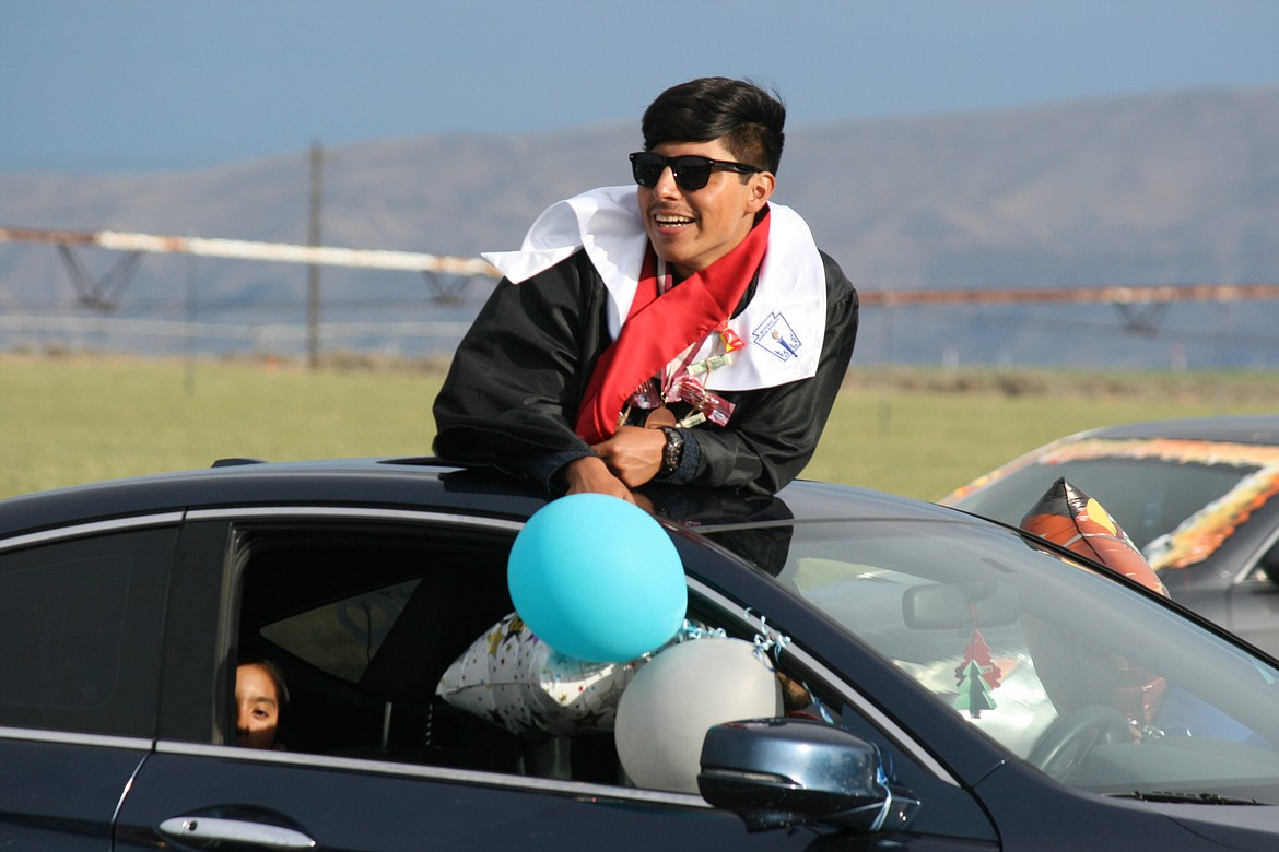 The Wahluke High School class of 2020 celebrated graduation in a unique fashion, with a car parade through Mattawa and extra precautions when they picked up their diplomas.