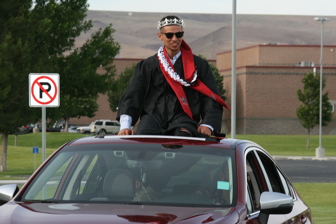 Cheryl Schweizer/Columbia Basin Herald   The Wahluke High School class of 2020 celebrated graduation in a unique fashion, with a car parade through Mattawa and extra precautions when they picked up their diplomas.