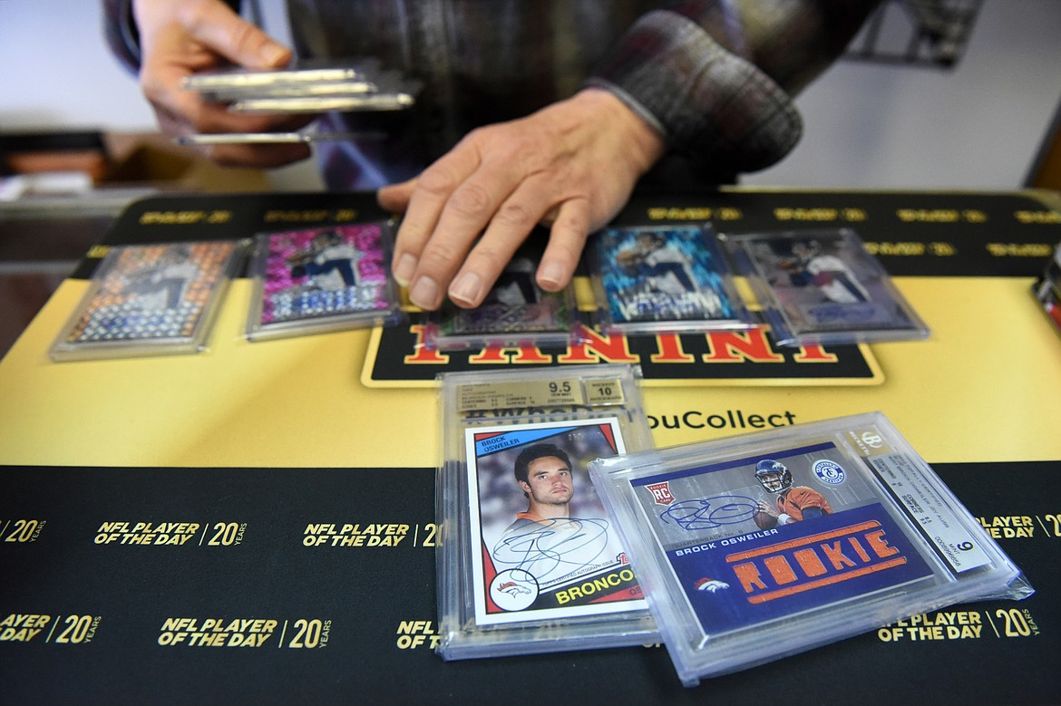 Tony Sibert sorts through a collection of signed Brock Osweiler cards at Sports Cards Plus.