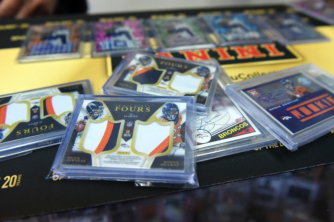 An Immaculate Fours card at Sports Cards Plus containing a small piece of jersey of four former Denver Broncos football players: Brock Osweiler, Ronnie Hillman, Cody Latimer and Emmanuel Sanders. (Casey Kreider/Daily Inter Lake)
