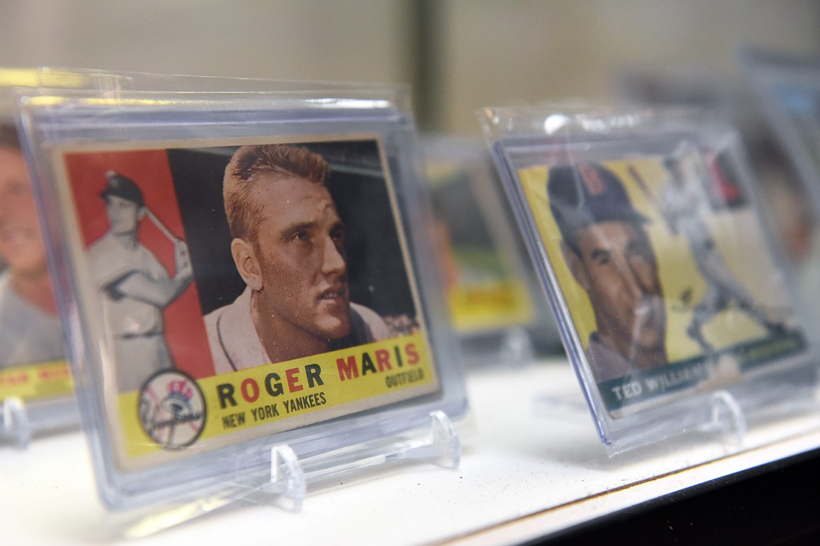 A 1960 Topps Roger Maris card and a 1955 Topps Ted Williams card for sale at Sports Cards Plus in Evergreen on Wednesday, June 10. (Casey Kreider/Daily Inter Lake)