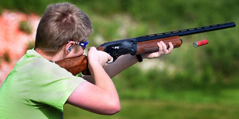 Nathan Kauffman (15) takes his shot during clay target practice at the Bigfork Gun Club Thursday. (Jeremy Weber/Bigfork Eagle)