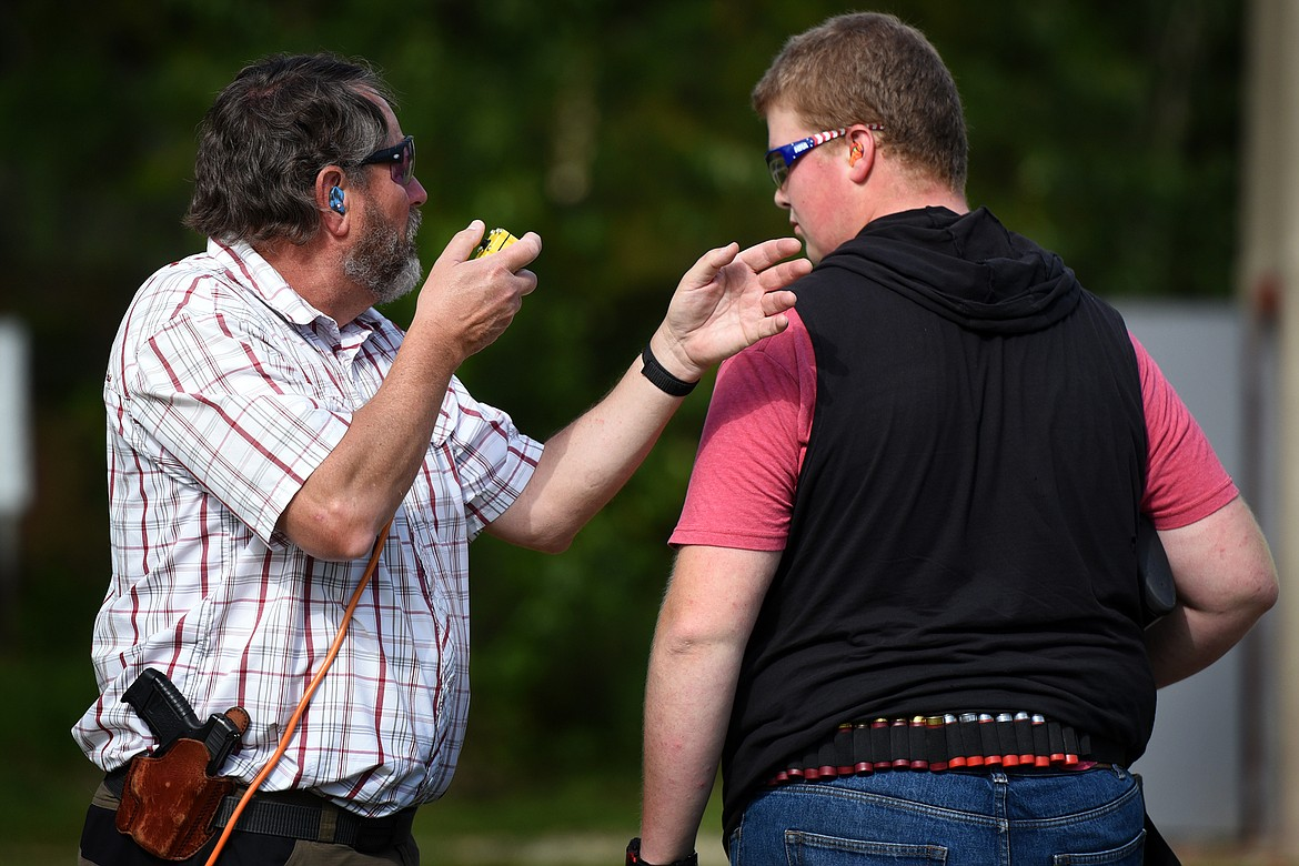Coach Robert Henneman gives instruction to shooter Gabe Kauffman during practice of the Bigfork Scholastic Clay Shooting Team last Thursday.