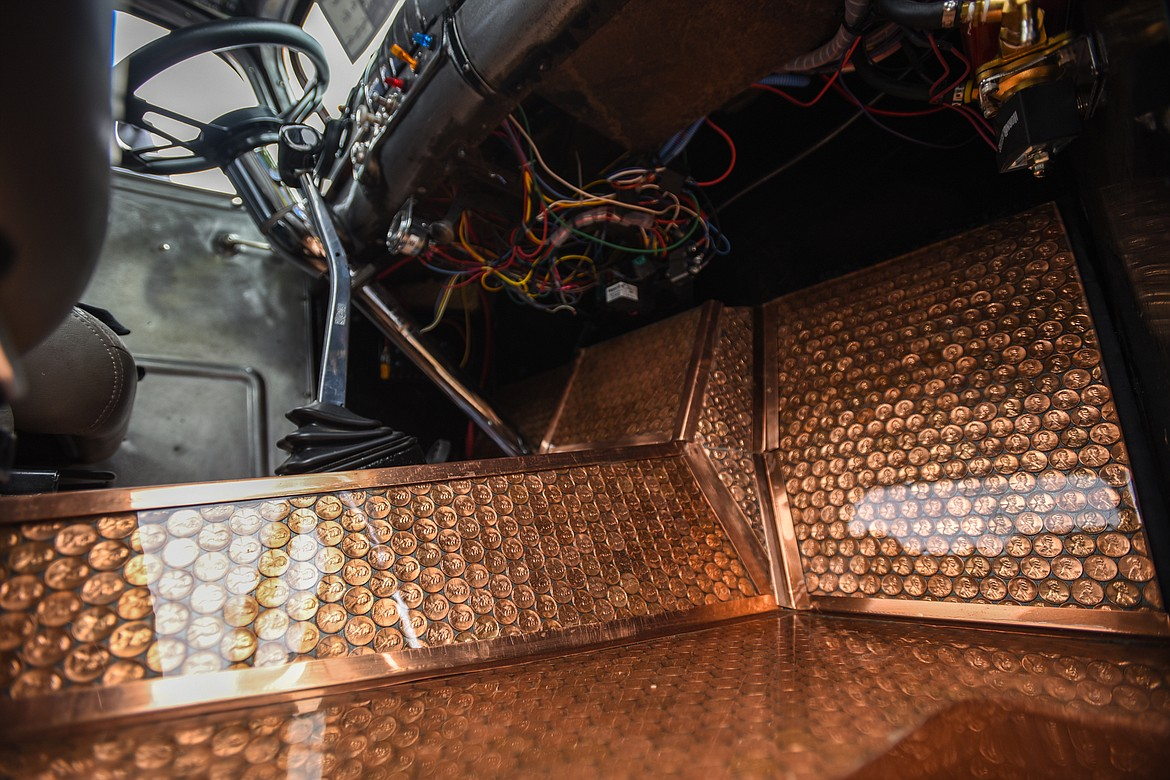 A total of 3,716 pennies were used to create the flooring inside Greg and Tana Greene's 1939 Chevy Rat Rod at The Big Shindig car show hosted by The Glacier Street Rod Association and The Desoto Grill in Kalispell on Saturday, June 20. (Casey Kreider/Daily Inter Lake)