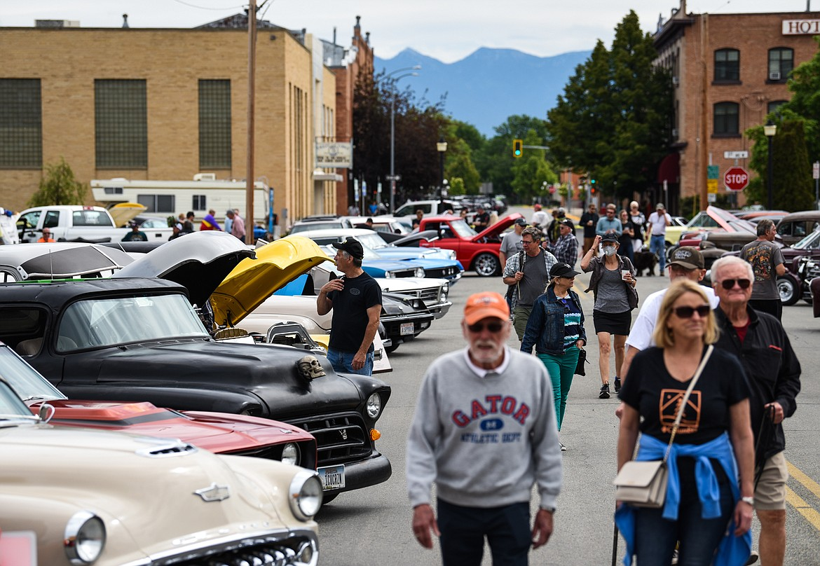 Attendees check out rows of classic cars at The Big Shindig car show hosted by The Glacier Street Rod Association and The Desoto Grill in Kalispell on Saturday, June 20. (Casey Kreider/Daily Inter Lake)