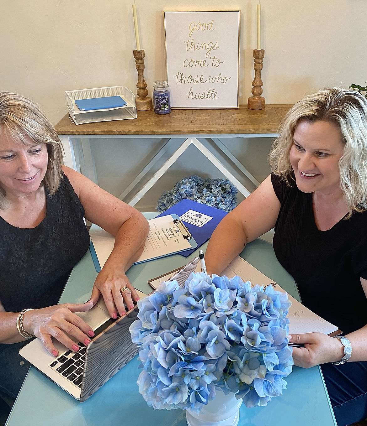 Kim Rose (left) and Jamie Wenzel (right) work on the digital components of home staging.