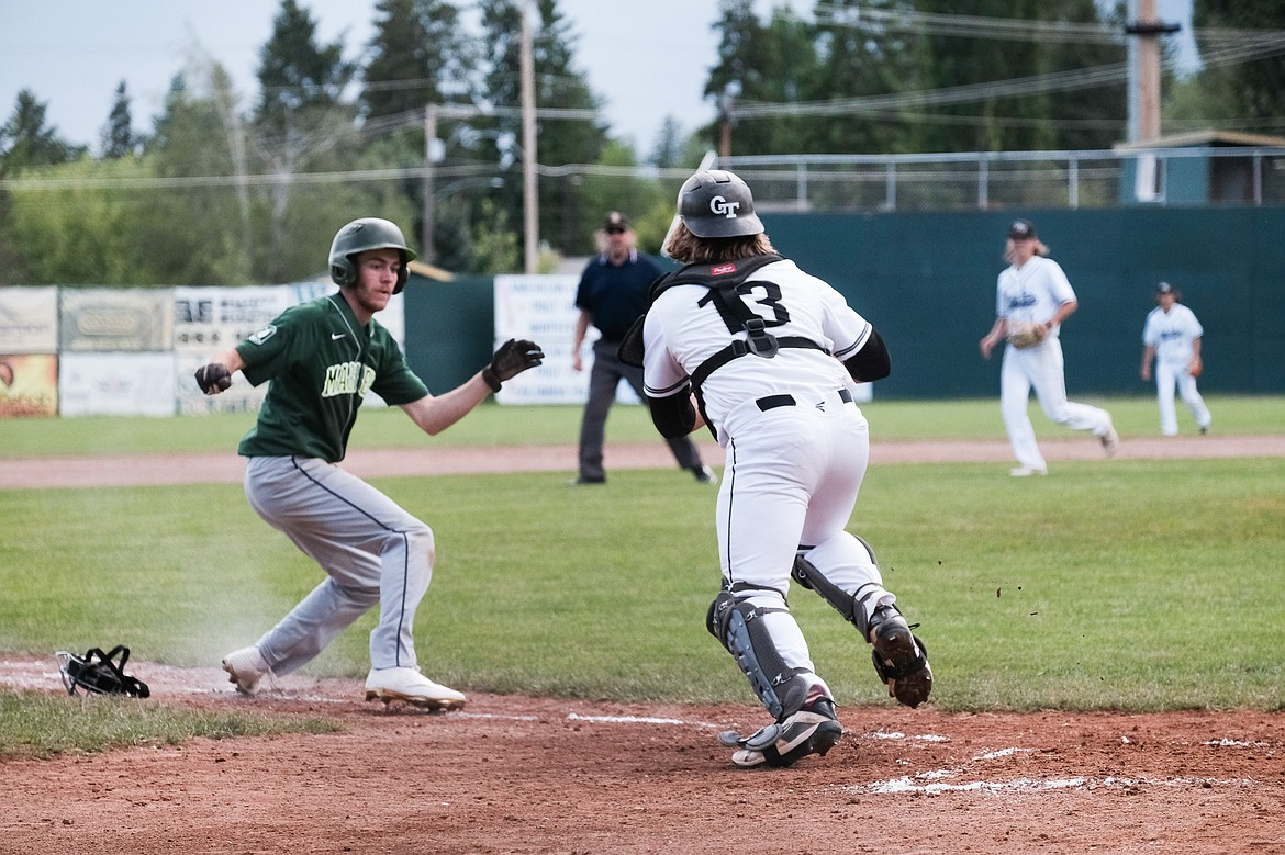 Zach Veneman tracks down a baserunner between home and third during Tuesday's game one win over the Mission Valley Mariners. (Daniel McKay/Whitefish Pilot)