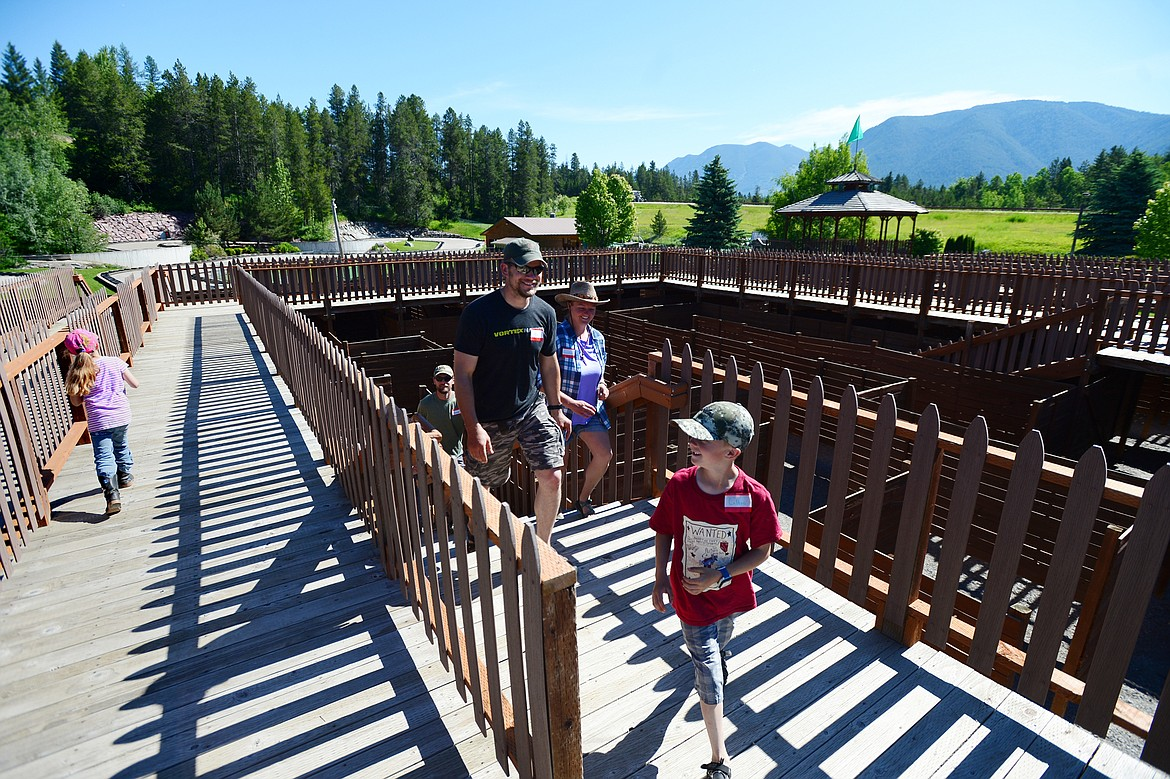 Visitors navigate the Glacier Maze which features 1   miles of passages and overhead walkways at the Amazing Fun Center in Coram on Tuesday, June 23. (Casey Kreider/Daily Inter Lake)