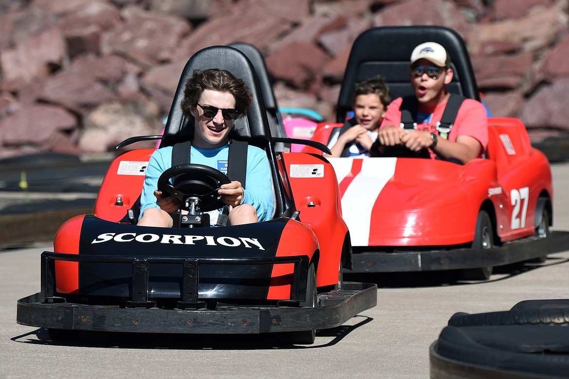 Visitors race on the go-kart track at Amazing Fun Center in Coram on Tuesday, June 23. (Casey Kreider/Daily Inter Lake)