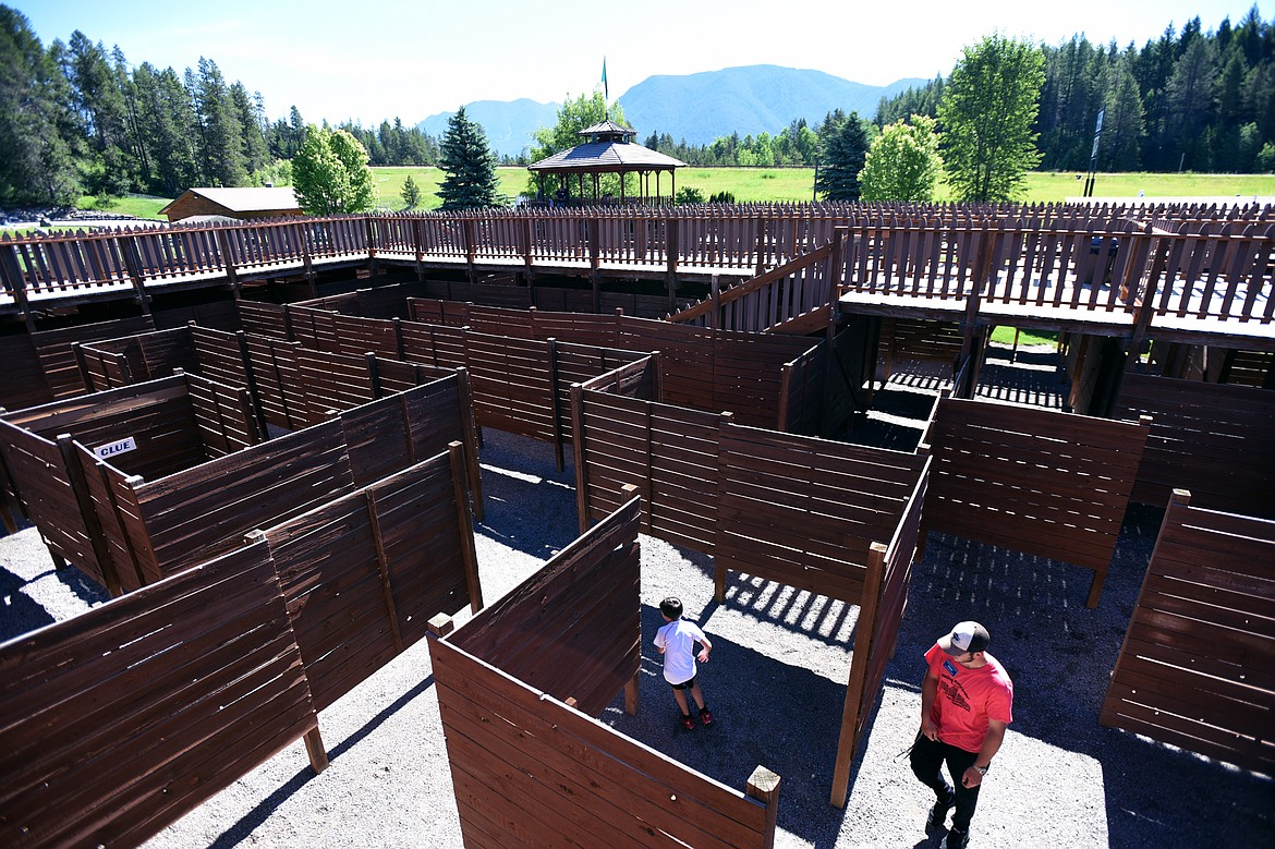 Visitors navigate the Glacier Maze which features 1   miles of passages and overhead walkways, at the Amazing Fun Center in Coram.