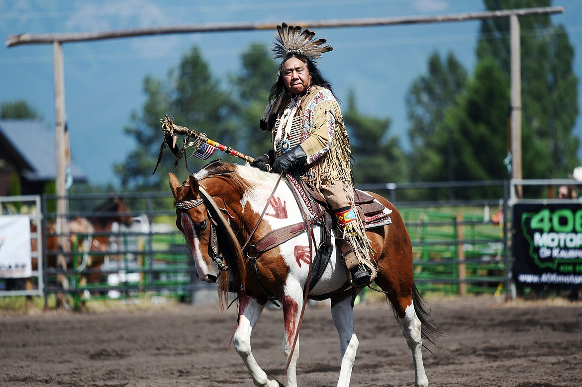 Aarie Mad Plume, of The Blackfeet Nation, is honored before the start of the Bigfork Rodeo on Saturday, July 4. (Casey Kreider/Daily Inter Lake)