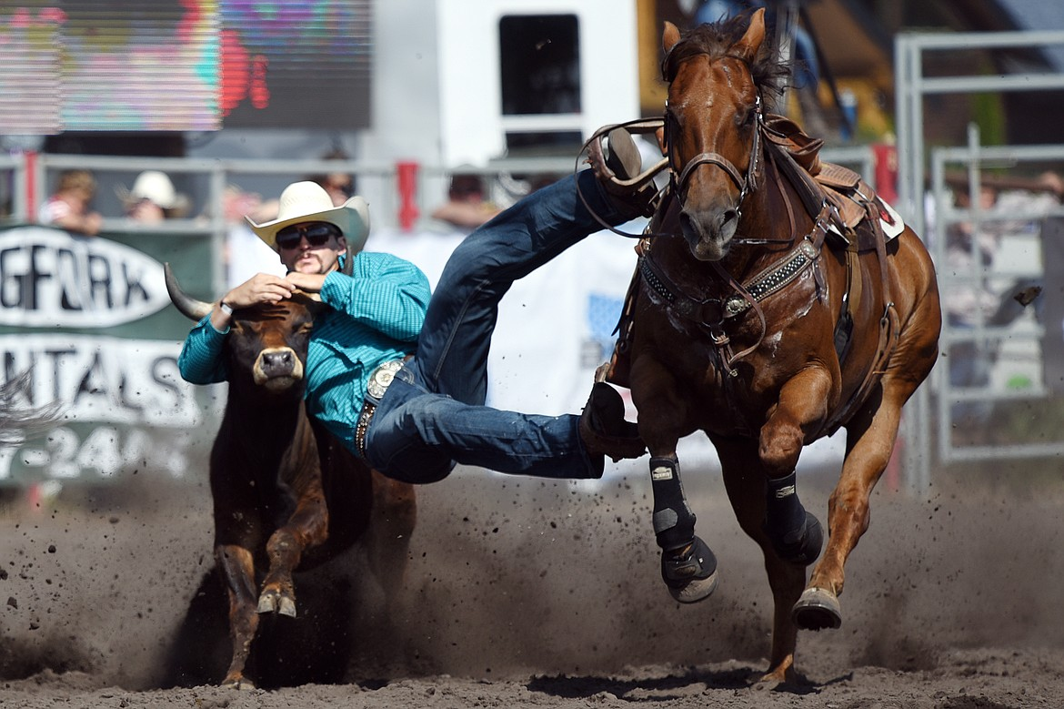 Tony Martinez, of Ellensburg, Washington, competes in steer wrestling at the Bigfork Rodeo on Saturday, July 4. (Casey Kreider/Daily Inter Lake)