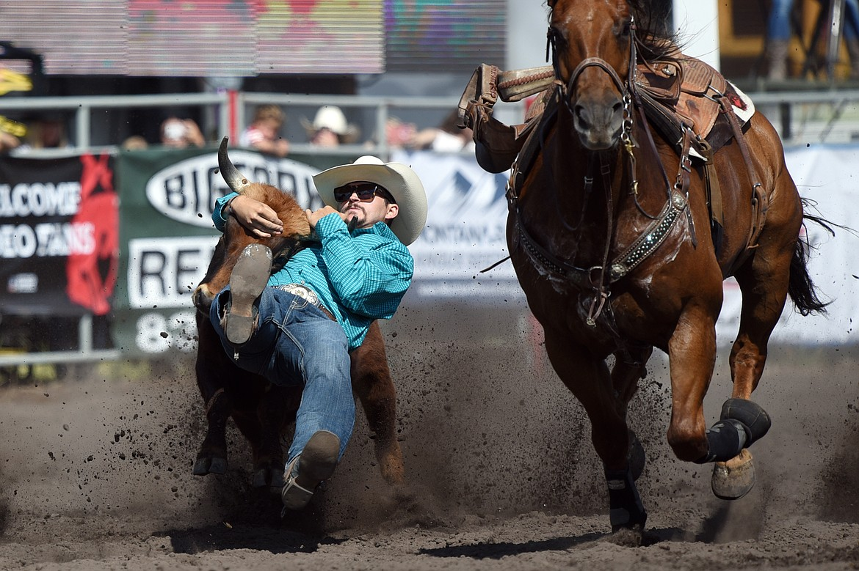 Tony Martinez, of Ellensburg, Washington, competes in steer wrestling at the Bigfork Rodeo on Saturday, July 4. (Casey Kreider/Daily Inter Lake)