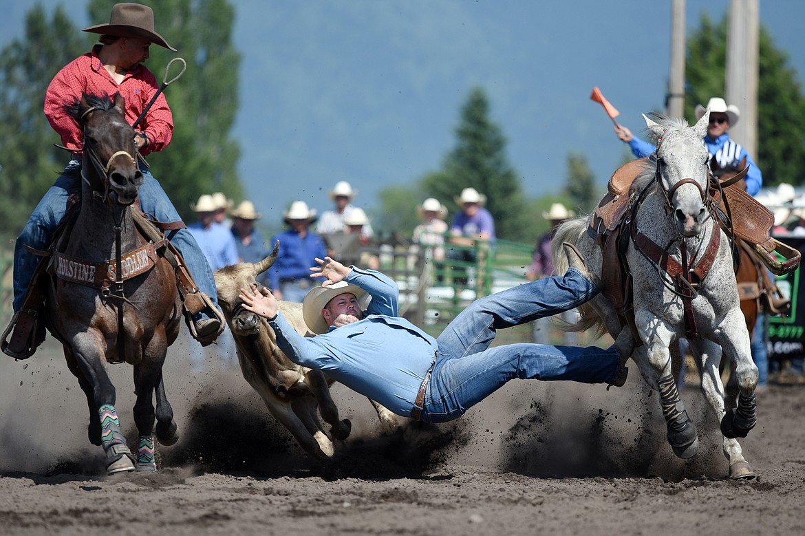 Shane Bullock, of Spokane, Washington, competes in steer wrestling at the Bigfork Rodeo on Saturday, July 4. (Casey Kreider/Daily Inter Lake)