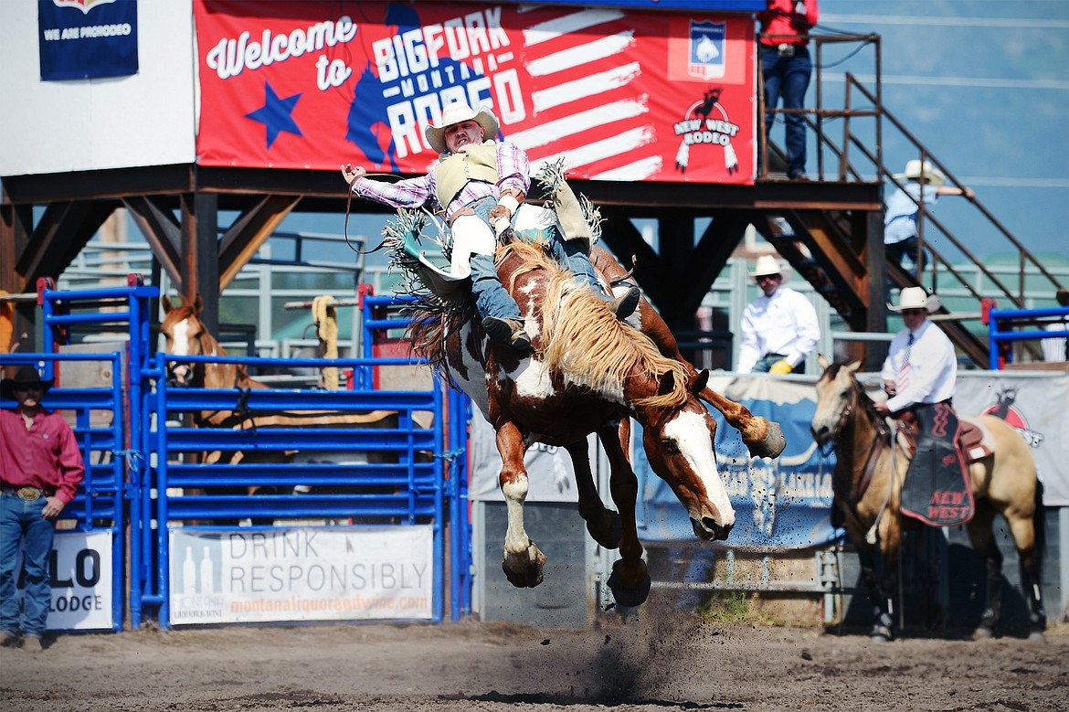 Trevor McAllister, of Ronan, holds on to his horse James Bond during bareback riding at the Bigfork Rodeo on Saturday, July 4. (Casey Kreider/Daily Inter Lake)