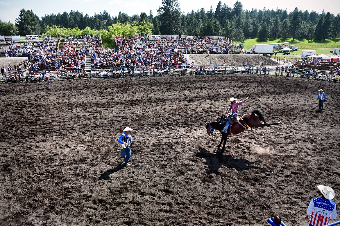 Ryan Verling, of Stanfield, Oregon, holds on to his horse during saddle bronc riding at the Bigfork Rodeo on Saturday, July 4. (Casey Kreider/Daily Inter Lake)