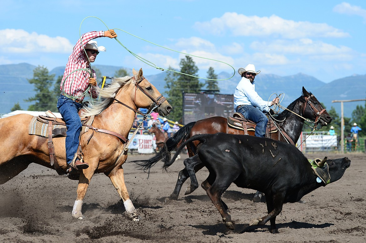 Brandon Brooks, left, of Whitefish, and Bart Slaney, of Whitefish, compete in team roping at the Bigfork Rodeo on Saturday, July 4. (Casey Kreider/Daily Inter Lake)