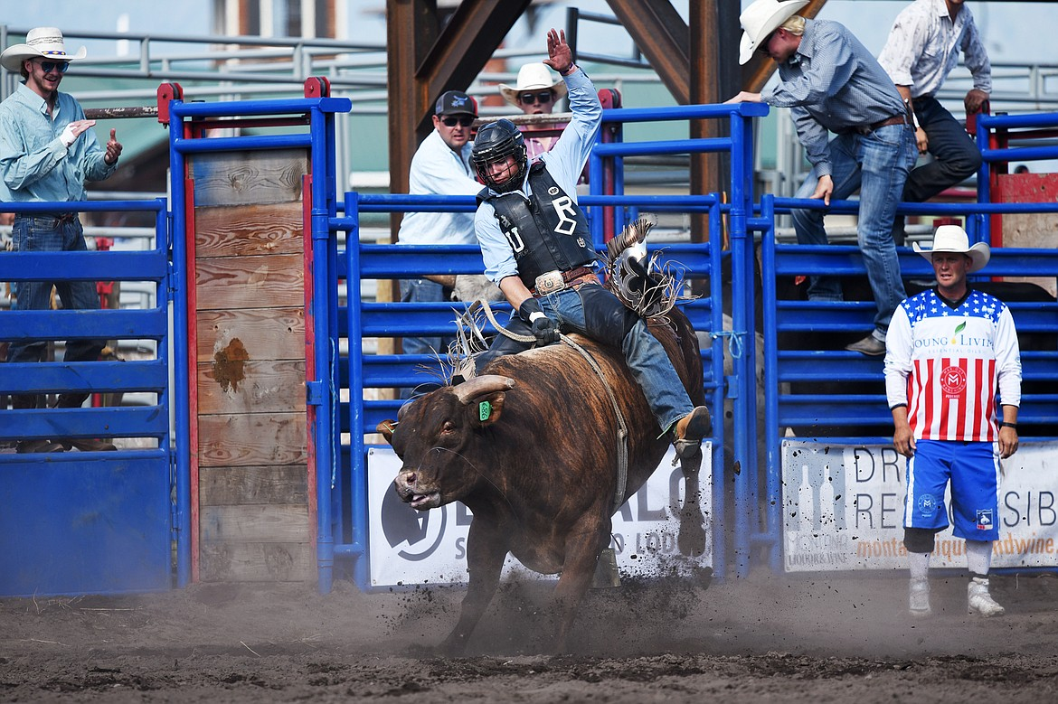 Ray Mayo, of Susanville, California, holds on to his bull Big Black during bull riding at the Bigfork Rodeo on Saturday, July 4. (Casey Kreider/Daily Inter Lake)