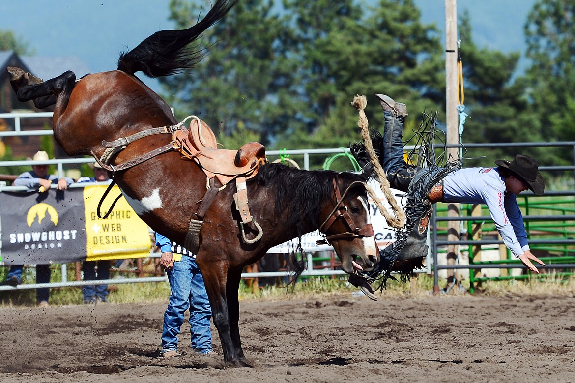 Colt Gordon, of Comanche, Oklahoma, gets thrown from his horse Kool Toddy during saddle bronc riding at the Bigfork Rodeo on Saturday, July 4. (Casey Kreider/Daily Inter Lake)