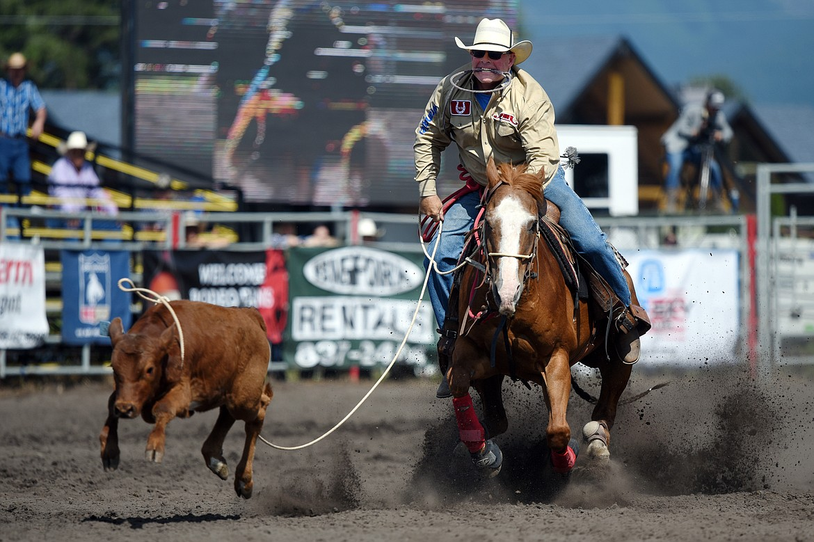 Vance Ruff, of Belgrade, lassos a calf during tie down roping at the Bigfork Rodeo on Saturday, July 4. (Casey Kreider/Daily Inter Lake)