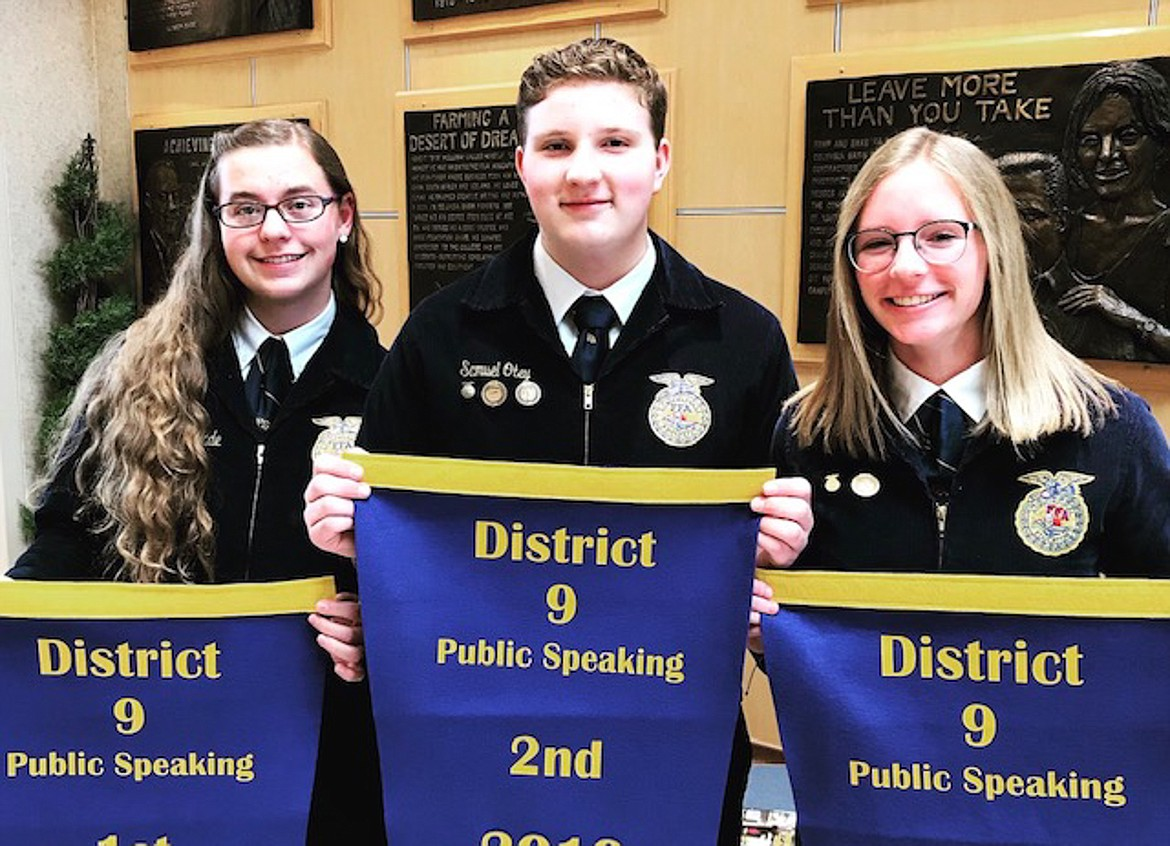 Left to right, Elisha Wade, Samuel Otey, and Maci Loutherback hold up their awards for the Public Speaking contest at the District IX competition in the spring.