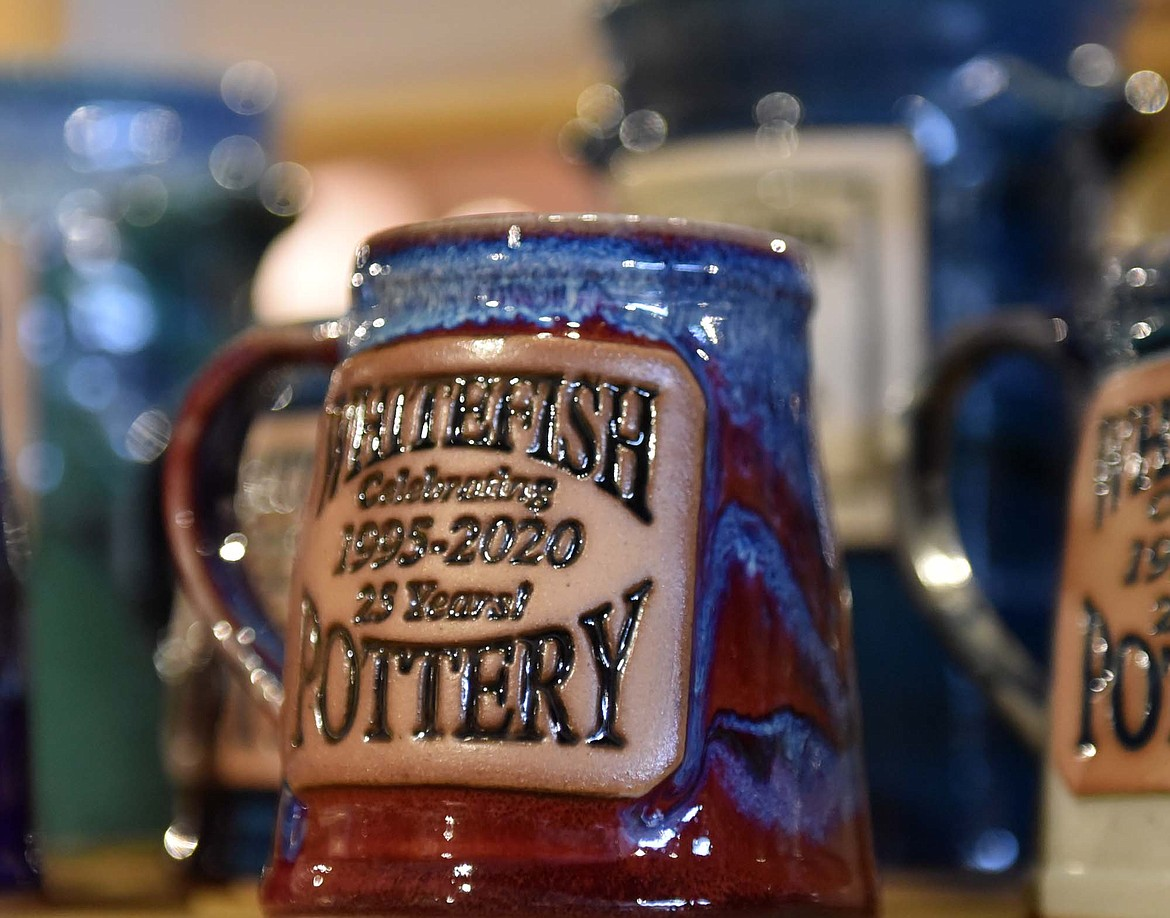 A shelf of Whitefish Pottery mugs celebrate the business' 25th anniversary. (Heidi Desch/Whitefish Pottery)