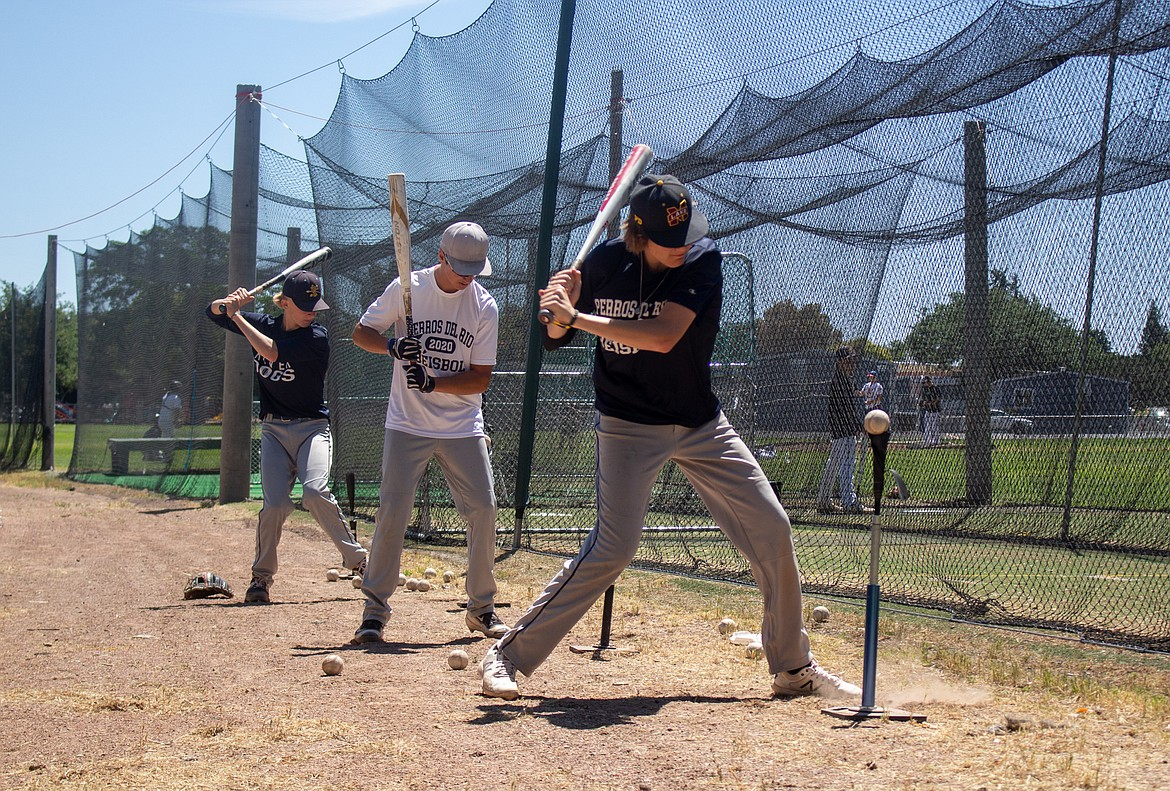 Columbia Basin Riverdogs players line up, spaced apart, for hitting practice on Wednesday as the team looks to ride their current momentum into the weekend.