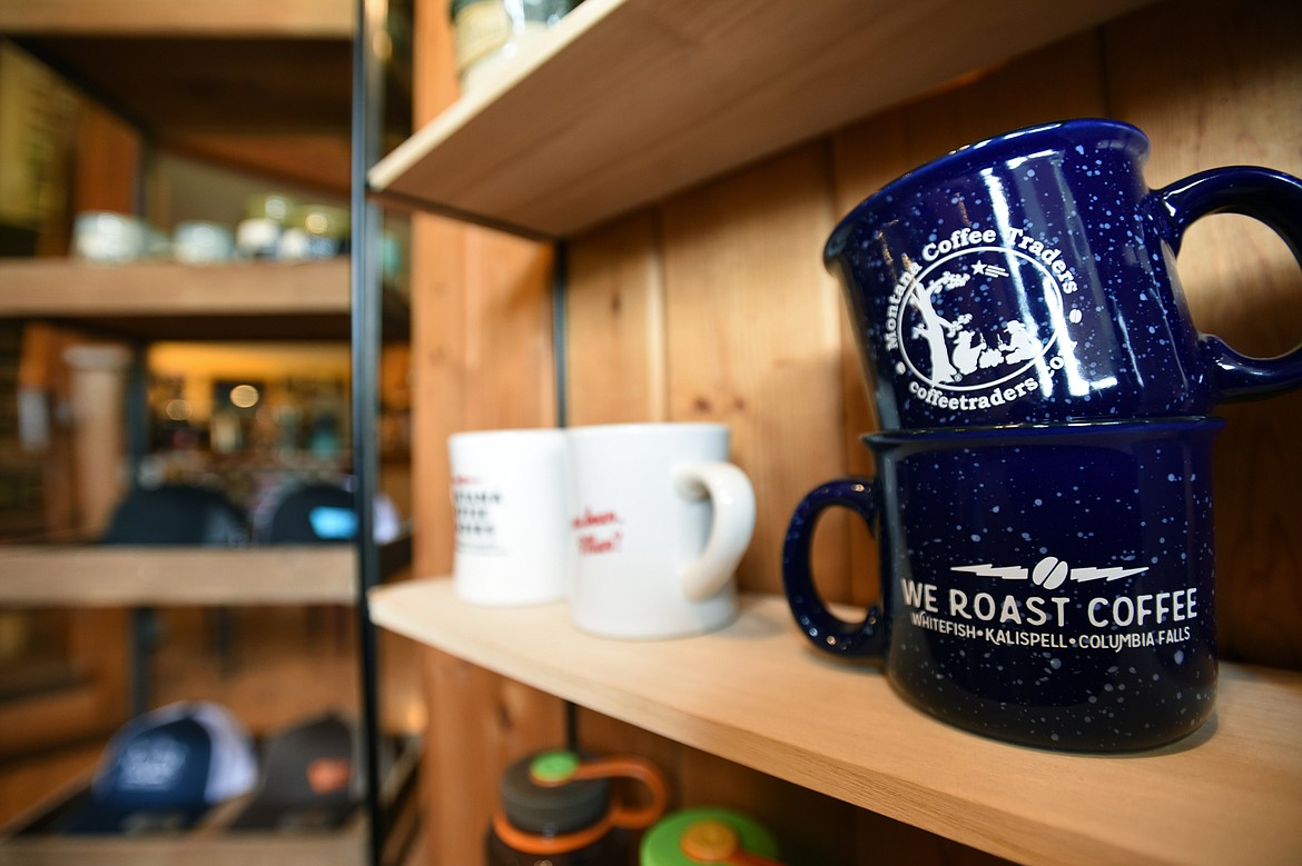 A selection of mugs, hats and merchandise on display at the Montana Coffee Traders Mercantile on U.S. 93 in Whitefish on Wednesday, July 8. (Casey Kreider/Daily Inter Lake)