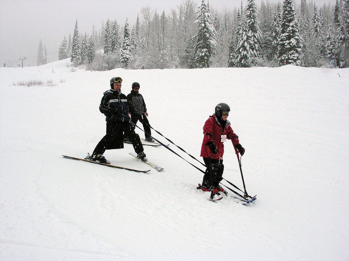 Jerry Mahugh helps a local man with cerebral palsy learn to ski. (Photo provided by DREAM Adaptive)