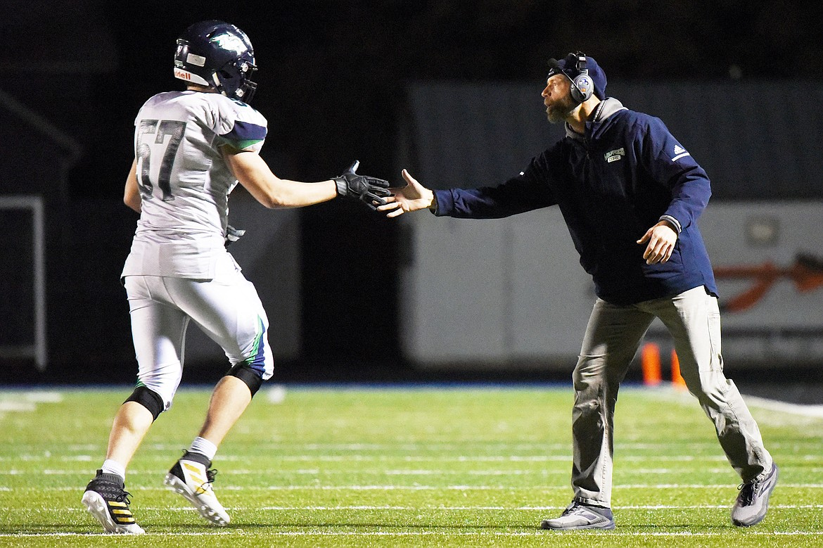 Glacier head coach Grady Bennett congratulates defensive lineman Henry Nuce (57) in the second half against Flathead during a crosstown matchup at Legends Stadium on Friday, Oct. 18, 2019. (Casey Kreider/Daily Inter Lake)