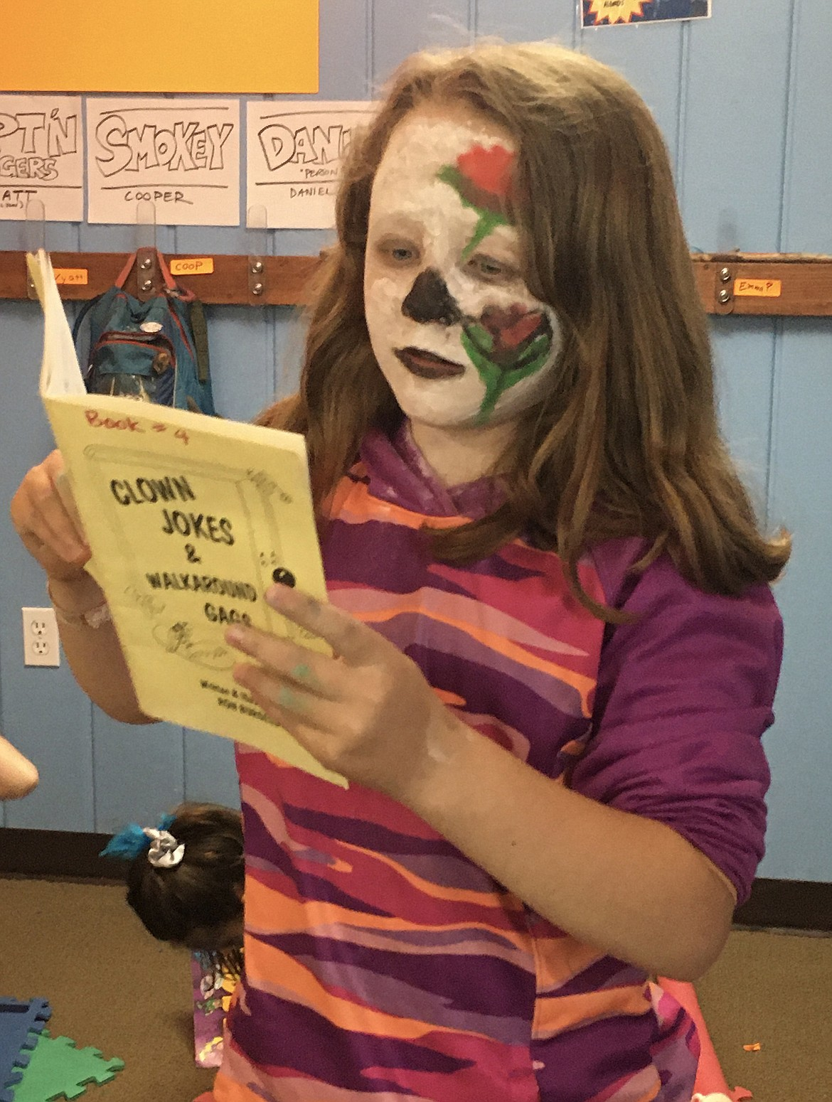 """Audrey Corder enjoys the Bigfork A.C.E.S. After School Program's """"Under the Big Top"""" camp, where the kids learned clowning, acrobatics, magic and circus stunts. (photo provided)"""
