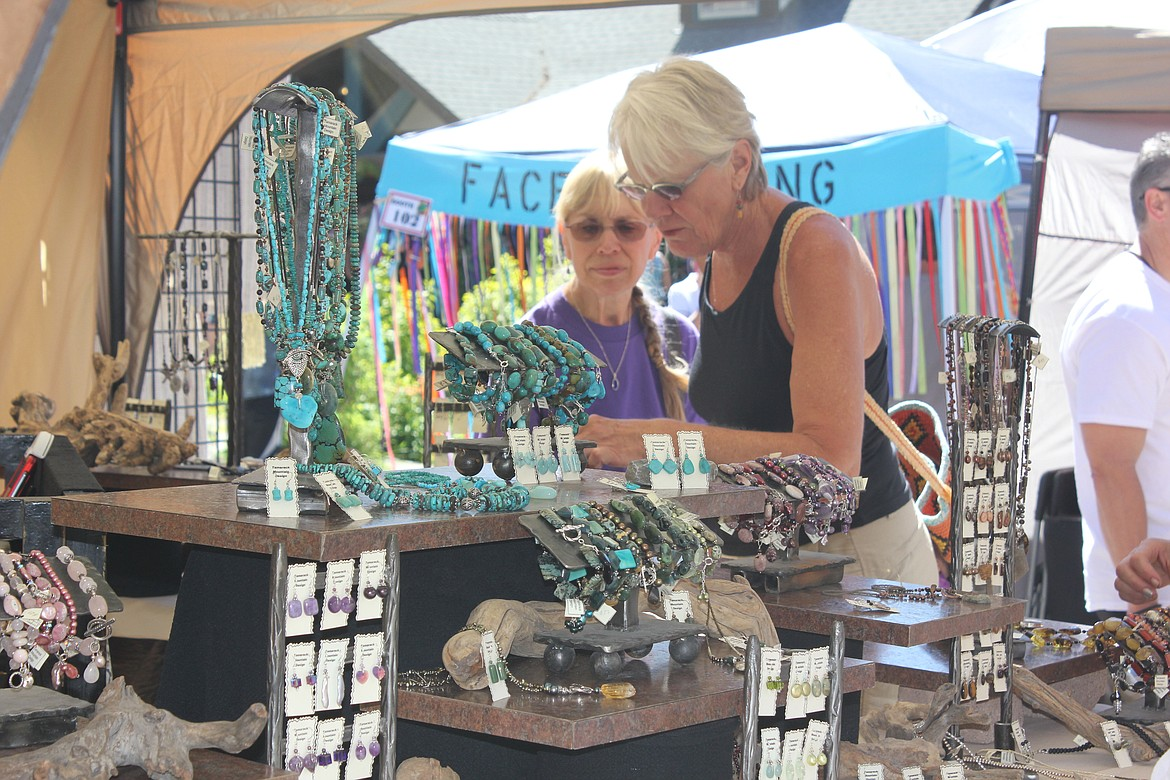 Courtesy Bigfork Area Chamber of Commerce Customers browse a display of turquoise jewelry during the Bigfork Festival of the Arts.