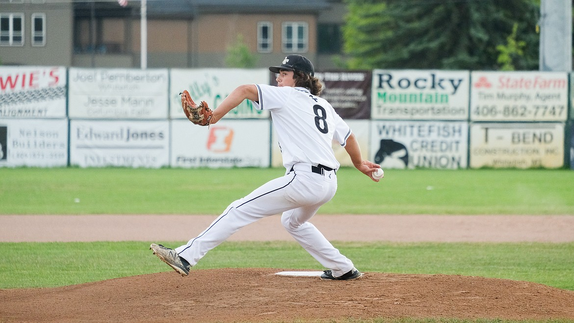 Mason Peters winds up for a pitch during Friday's loss to the Missoula Mavericks AA at home. (Daniel McKay/Whitefish Pilot)