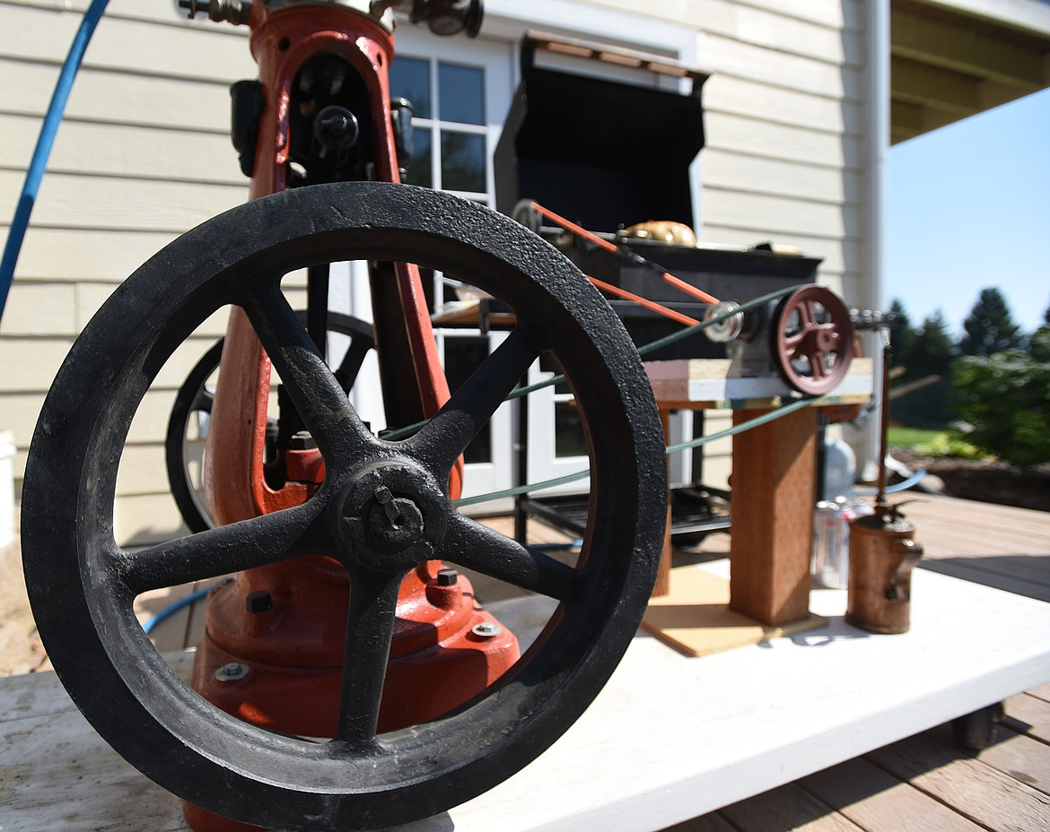 Built from an 1890s steam engine, a Weber grill and a collection of scavenged parts, Don Bumgarner's rotisserie grill sits outside his house in Lakeside. (Jeremy Weber/Daily Inter Lake)
