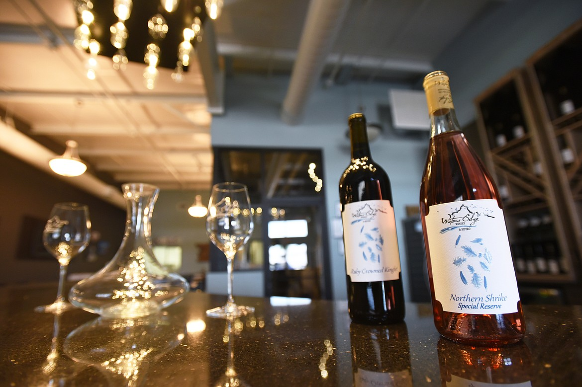 A pair of wines, Ruby Crowned Kinglet, a red, and Northern Shrike Special Reserve, a white, on display at Waters Edge Winery & Bistro in Evergreen on Thursday, July 30. (Casey Kreider/Daily Inter Lake)